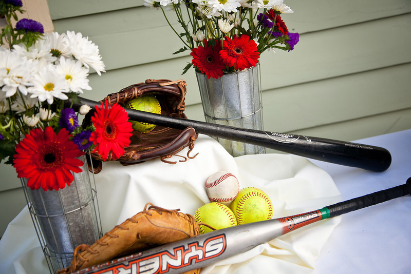 Rustic daisy bouquets with baseball & softball gear as decor at this McKinney wedding! | Wedding Photography in Dallas, Texas & Beyond by Mary Cyrus