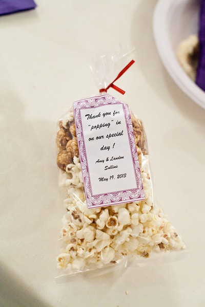 """Thank you for popping by"" written on these popcorn wedding favors 