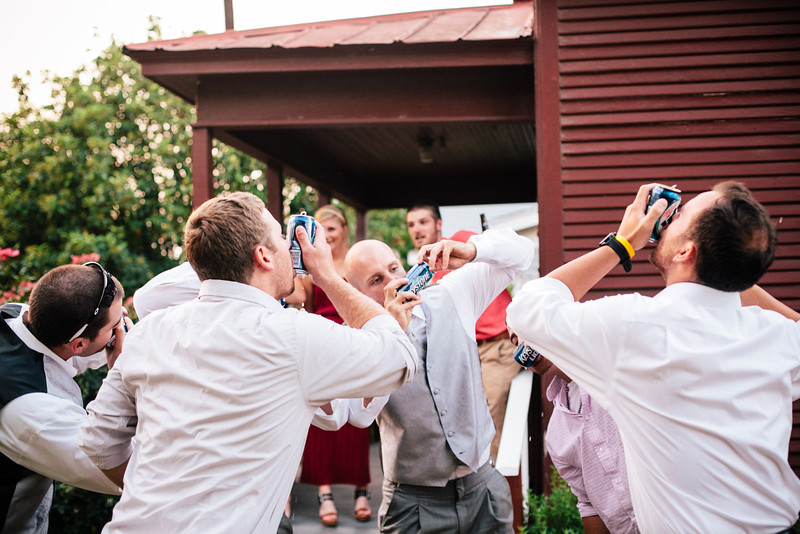 Groomsmen shotgunning beers at a Chestnut Square wedding | Wedding Photography in Dallas, Texas & Beyond by Mary Cyrus